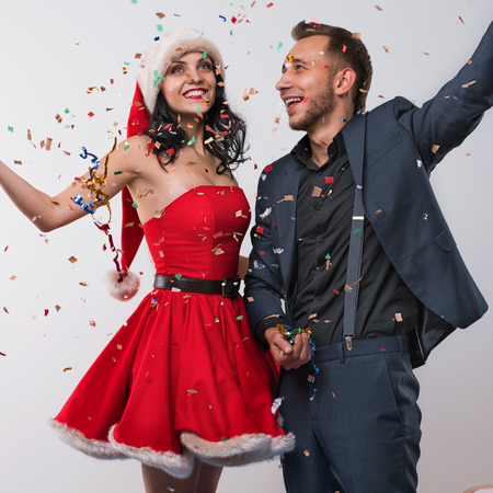 new year eve: Portrait of two people man and woman in love celebrating new year eve or christmas party Stock Photo