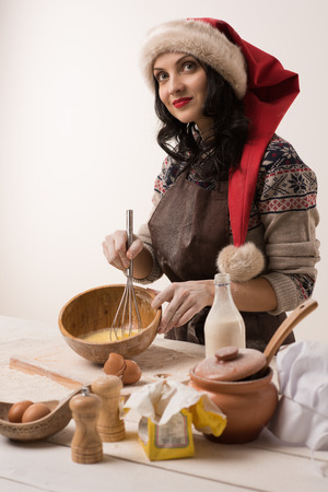 Woman cooking Christmas cookies photo