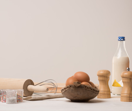 Ingredients for dough on white wooden table photo