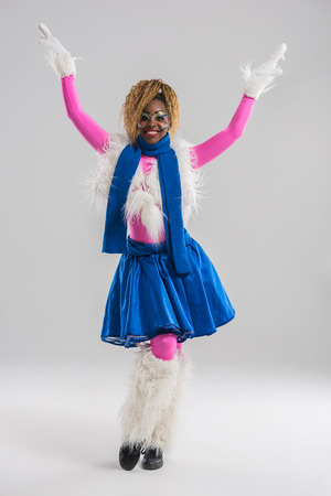 Festive african woman wearing funny costume posing on gray background photo