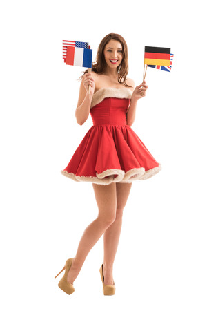 Sexy girl wearing Santa Claus clothes holding national flags photo