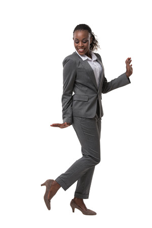 business woman legs: Smiling female businesswoman dancing and her legs crossed against a white background Stock Photo