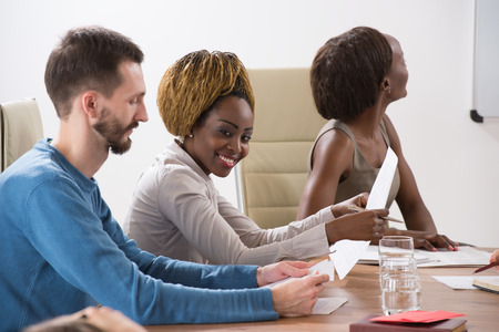 collaborators: Business meeting at office . Multi ethnic group of people Stock Photo