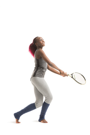 dross: Full length portrait of young african woman playing tennis on a dross field Healthy lifestyle Isolated white background