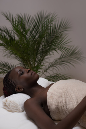 Spa African Woman in Beauty Salon photo