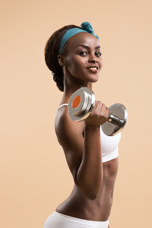 hand weights: Woman in sport clothes practice with hand weights Stock Photo