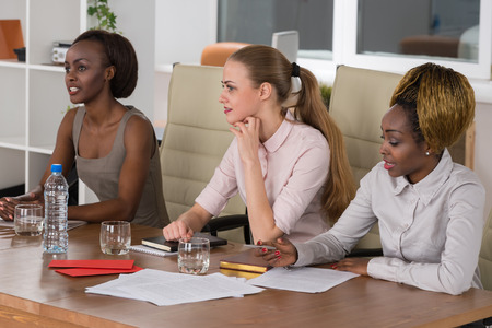 Mixed group in business meeting women only Imagens
