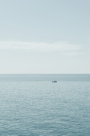 fishers: Lonely fishers boat in ocean