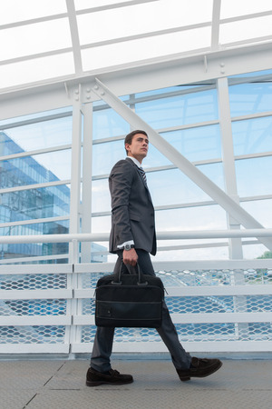go inside: Businessman walking in urban environment of airport or office building Stock Photo