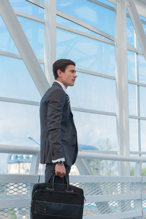 urban environment: Businessman walking in urban environment of airport or office building Stock Photo