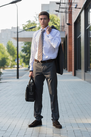 urban environment: Portrait of an handsome businessman standing in an urban environment Stock Photo