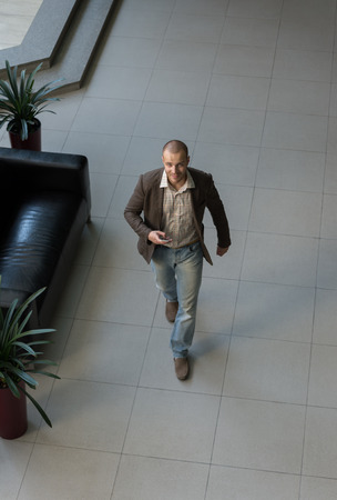 power walking: Top view of successful positive businessman