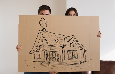my home: Mortgage and credit concept. Young couple relocating to new home