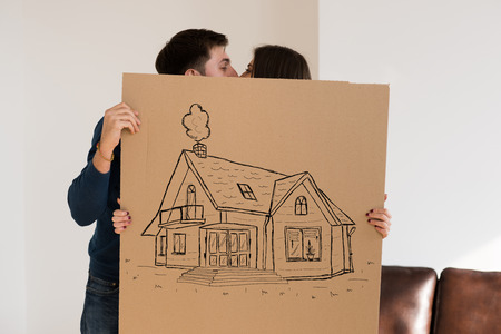 relocating: Mortgage and credit concept. Young couple relocating to new home