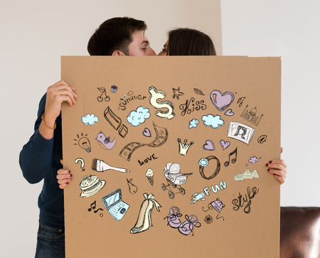 Shopping and credit concept. Young couple planning their future at new home Stock Photo