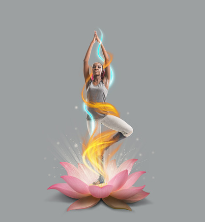 Young african woman in the stretching position in lotus flower stock stock photo young african woman in the stretching position in lotus flower mightylinksfo