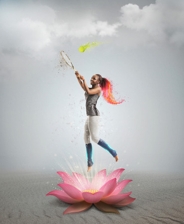 Full length portrait of young african woman playing tennis bright collage with fire and splashes in lotus flower photo