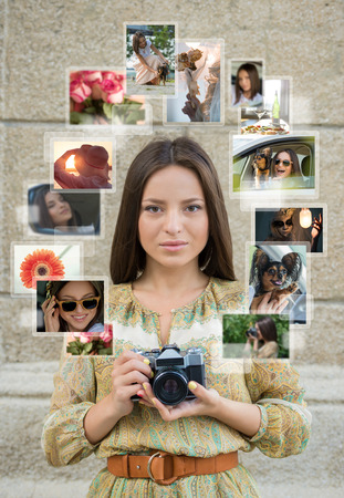 Young girl with retro camera and many images around her. Sharing photo in social media network concept photo