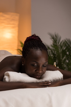 Spa African Woman in Beauty Salon Relaxing photo
