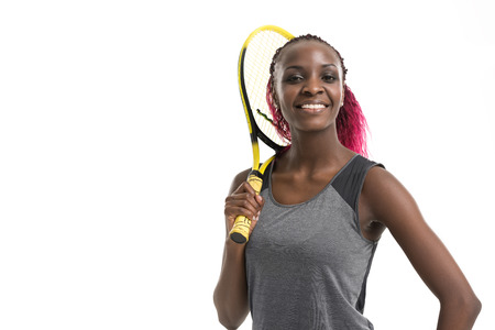 Half length portrait of young woman playing tennis on a dross field. Healthy lifestyle. Isolated white background Stock Photo
