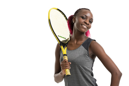 dross: Half length portrait of young woman playing tennis on a dross field. Healthy lifestyle. Isolated white background Stock Photo