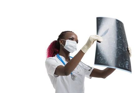 radiographic: Closeup portrait of intellectual african woman healthcare doctor with white labcoat, looking at brain x-ray radiographic image, ct scan, mri, isolated white background. Radiology department Stock Photo