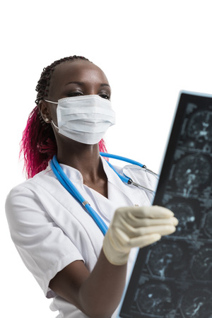 labcoat: Closeup portrait of intellectual african woman healthcare doctor with white labcoat, looking at brain x-ray radiographic image, ct scan, mri, isolated white background. Radiology department Stock Photo