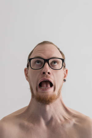 Screaming man portrait against plain background photo
