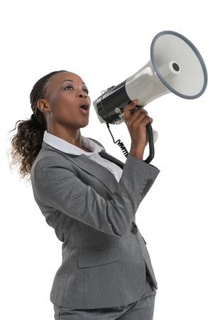 megafono: Mujer de negocios africana que habla por el megáfono aislado en el fondo blanco Foto de archivo