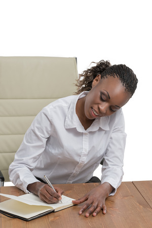 office note: African business woman sitting at her desk and planning isolated on white background Stock Photo