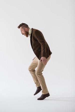 Full length portrait of modern groom dancing Stock Photo