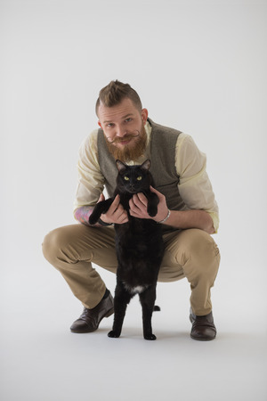 full length portrait: Full length portrait of modern groom posing with his cat