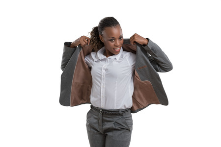 African business woman putting on jacket isolated on white background Stock Photo