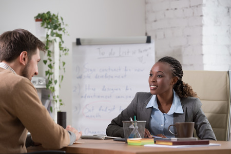 female boss: Emotional businesswoman gesturing during meeting at office