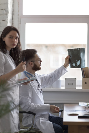 medical doctors: Doctors discussing intestines xray at medical office