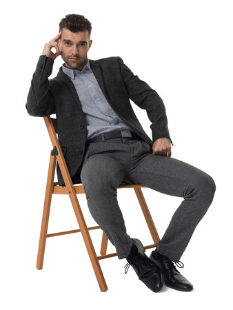 Businessman sitting on chair and thinking portrait isolated on white background