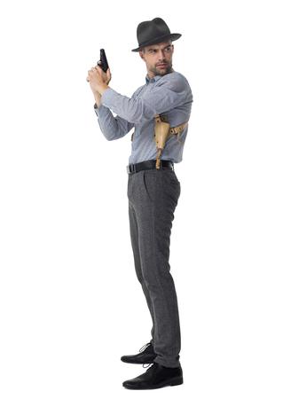 gun man: Businessman with gun posing portrait isolated on white background