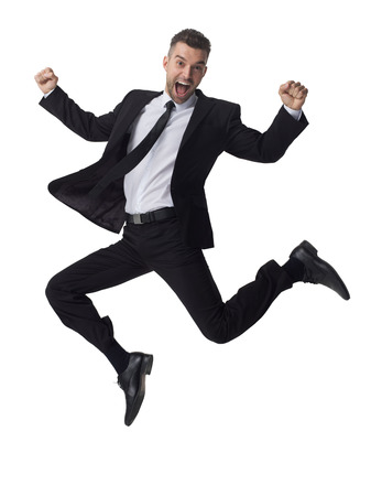 Businessman jumping full length portrait isolated on white background Imagens