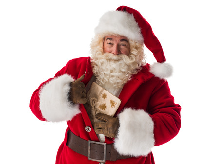 concealed: Santa Claus Portrait. Getting out concealed gift box from bosom Stock Photo
