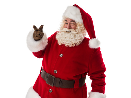 Portret van de Kerstman wijzend op copyspace geïsoleerd op witte achtergrond Stockfoto