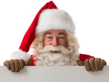papa noel: Santa Claus la celebración de firmar en blanco copyspace. Retrato aislado en fondo blanco Foto de archivo