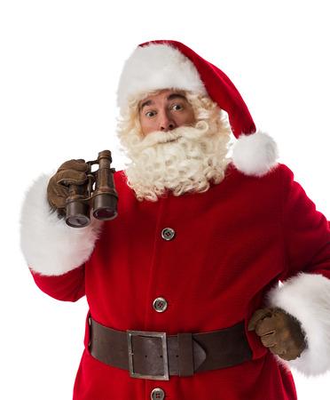 wondered: Santa Claus with vintage binoculars Closeup Portrait