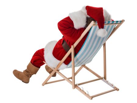 beach chair: Santa Claus resting on deck chair Full-Length Portrait