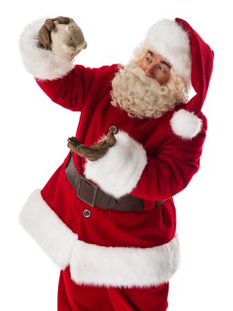 holiday profits: Santa Claus with piggy bank Closeup Portrait