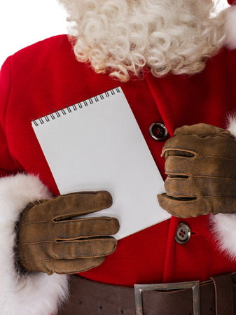 bosom: Santa Claus hiding notepad to bosom Closeup Portrait. Isolated on White Background