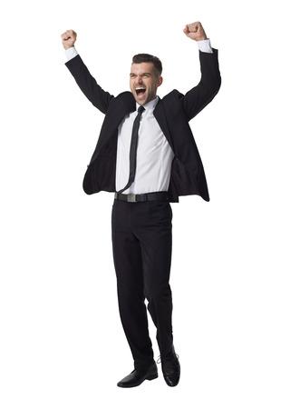 exito: El hombre de negocios de éxito celebrando Retrato integral aislado en el fondo blanco