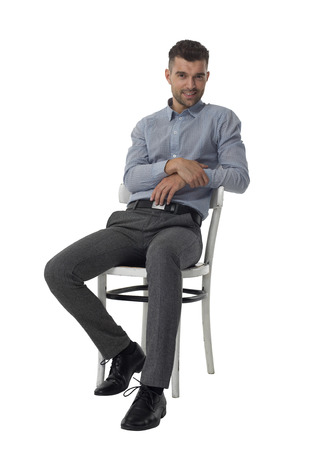 sitting: Businessman sitting on chair and thinking Full Length Portrait isolated on White Background Stock Photo