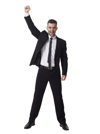 Zakenman vieren succes Full Length Portret geïsoleerd op witte achtergrond Stockfoto