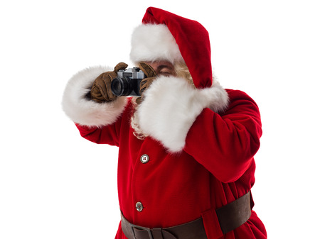 Santa Claus holding vintage camera Closeup Portrait. Isolated on White Background Stock Photo