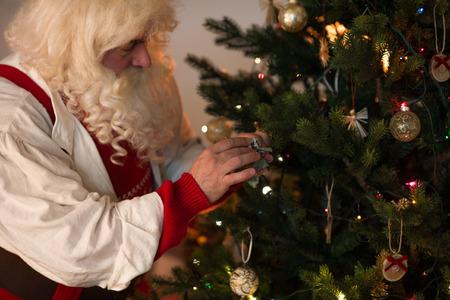 home decorating: Santa Claus at Home decorating Christmas Tree